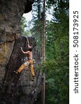 Small photo of Man is climbing on rock. Success climbing, reaching the top Adrenalin, strength, ambition.