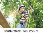 boy enjoys climbing high wire... | Shutterstock . vector #508199071