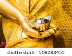 Golden Hand Buddha Statue With...