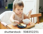 little girl eating with spoon... | Shutterstock . vector #508352251