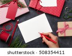 Female Writing Christmas...