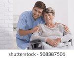 male nurse hugging his senior...   Shutterstock . vector #508387501