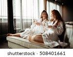 women in bathrobes enjoying tea ... | Shutterstock . vector #508401661