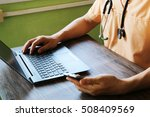 doctor's hand at computer typing | Shutterstock . vector #508409569