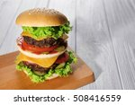 Tasty Burger On Wooden Board