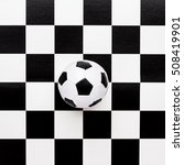 Soccer Ball On Chequered Black...