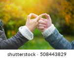 hands of two lovers on a... | Shutterstock . vector #508443829