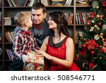happy young family in christmas ... | Shutterstock . vector #508546771