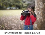 Little Girl Taking A Photo Wit...