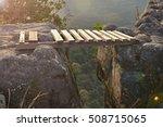 wooden bridge across the gap of ... | Shutterstock . vector #508715065