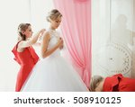 bridesmaid is helping to the... | Shutterstock . vector #508910125