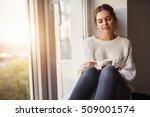 beautiful young woman drinking... | Shutterstock . vector #509001574