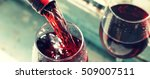 pouring wine into a glass | Shutterstock . vector #509007511