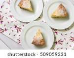 three slices of cheese cake on... | Shutterstock . vector #509059231