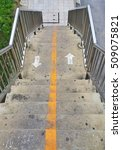 Small photo of white arrow icon and straight lines bisect yellow color, The pathway up and down The pedestrian overpass