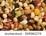 nuts and dried fruits background | Shutterstock . vector #509082274