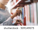 woman at the library  she is... | Shutterstock . vector #509149075