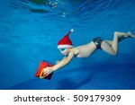 Little Boy Underwater In The...