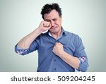 portrait of a crying man on... | Shutterstock . vector #509204245
