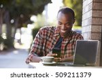 young black man outside a cafe... | Shutterstock . vector #509211379
