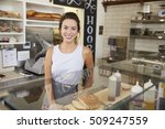 Small photo of Female business owner behind the counter at a sandwich bar