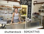 Woman Behind The Counter Of...