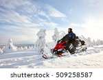 Man Driving Snowmobile In...