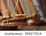 golden balance scales on wooden ... | Shutterstock . vector #509277019