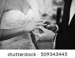 groom holds bride's finger with ... | Shutterstock . vector #509343445