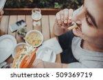 Young Man Eating A Hotdog