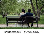 man and woman sitting on a bench | Shutterstock . vector #509385337