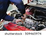 worker repairs a car in a car... | Shutterstock . vector #509465974