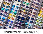 hundred of colorful sunglasses... | Shutterstock . vector #509509477