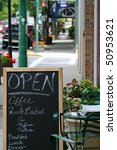 Open Sign And Menu On Sidewalk...