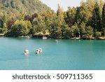 golden reflections on bled lake ...   Shutterstock . vector #509711365