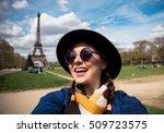 woman tourist at eiffel tower... | Shutterstock . vector #509723575