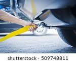 hand holding yellow car towing... | Shutterstock . vector #509748811