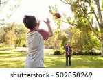 dad and son throwing american... | Shutterstock . vector #509858269