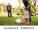 Parents Kicking A Ball With...