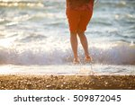 girl jumping on sea shore | Shutterstock . vector #509872045