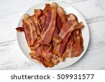 a small white plate of fried... | Shutterstock . vector #509931577