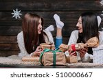 two beautiful girls lie on the... | Shutterstock . vector #510000667
