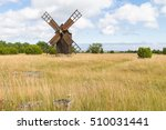 wooden windmill on a meadow