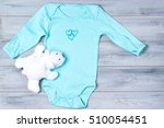 baby clothes and white toy bear ...   Shutterstock . vector #510054451