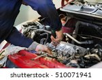 worker repairs a car in a car... | Shutterstock . vector #510071941