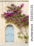 Blue Door With A Stone Wall An...