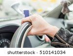 young woman sitting in car | Shutterstock . vector #510141034