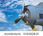 Small photo of Closeup airscrew on blue sky backgound, Old airplane