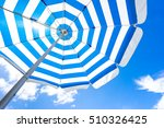 striped beach umbrella on the... | Shutterstock . vector #510326425