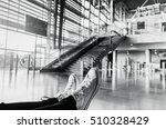 Small photo of Young girl waiting for airplane at terminal airport - Close up on sneakers shoes of woman sitting in gate air station - Black and white editing - Soft focus on right shoe - Vintage warm filter